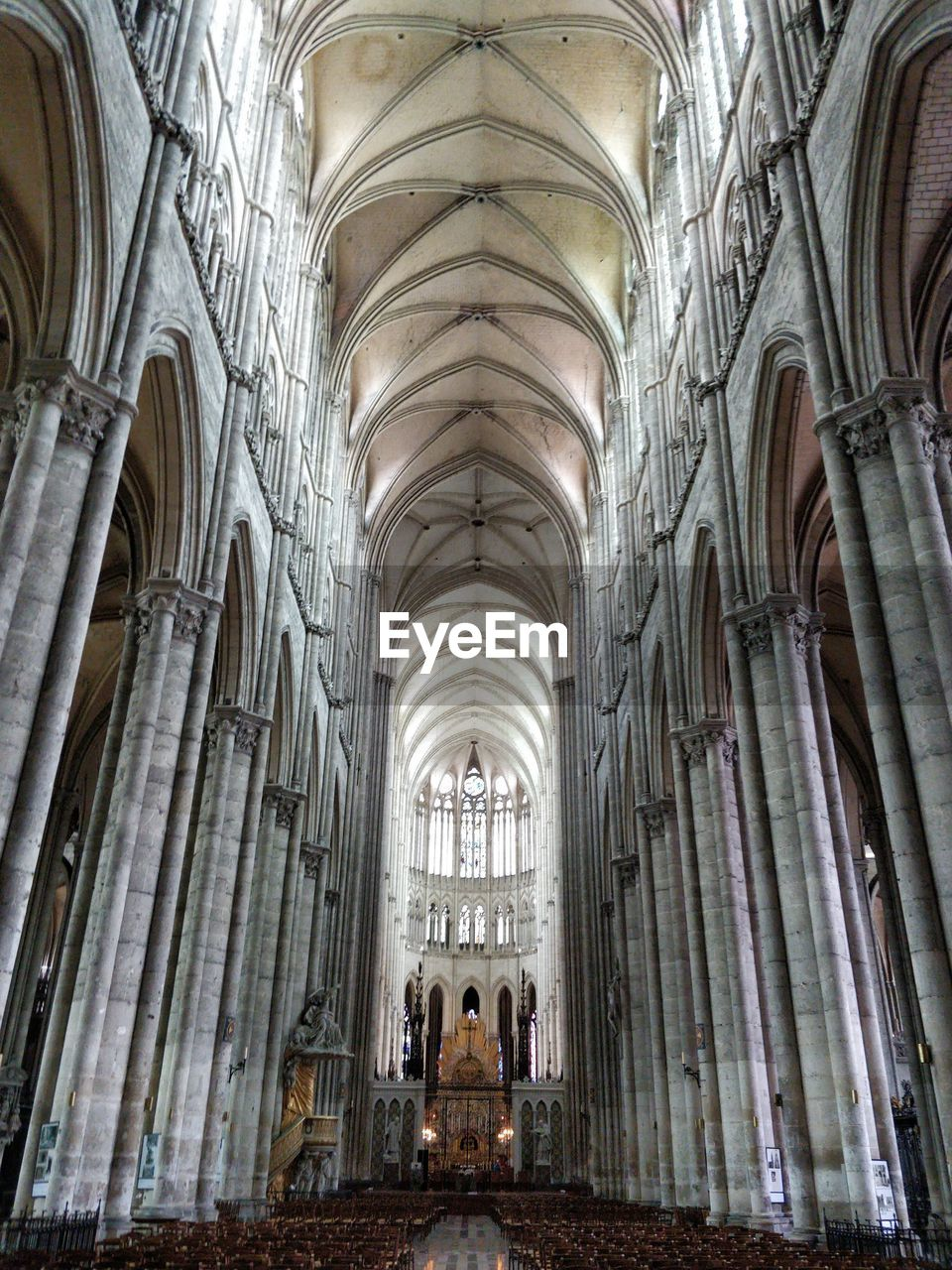 religion, belief, architecture, spirituality, built structure, place of worship, architectural column, building, indoors, arch, history, the past, travel destinations, incidental people, travel, ceiling, gothic style