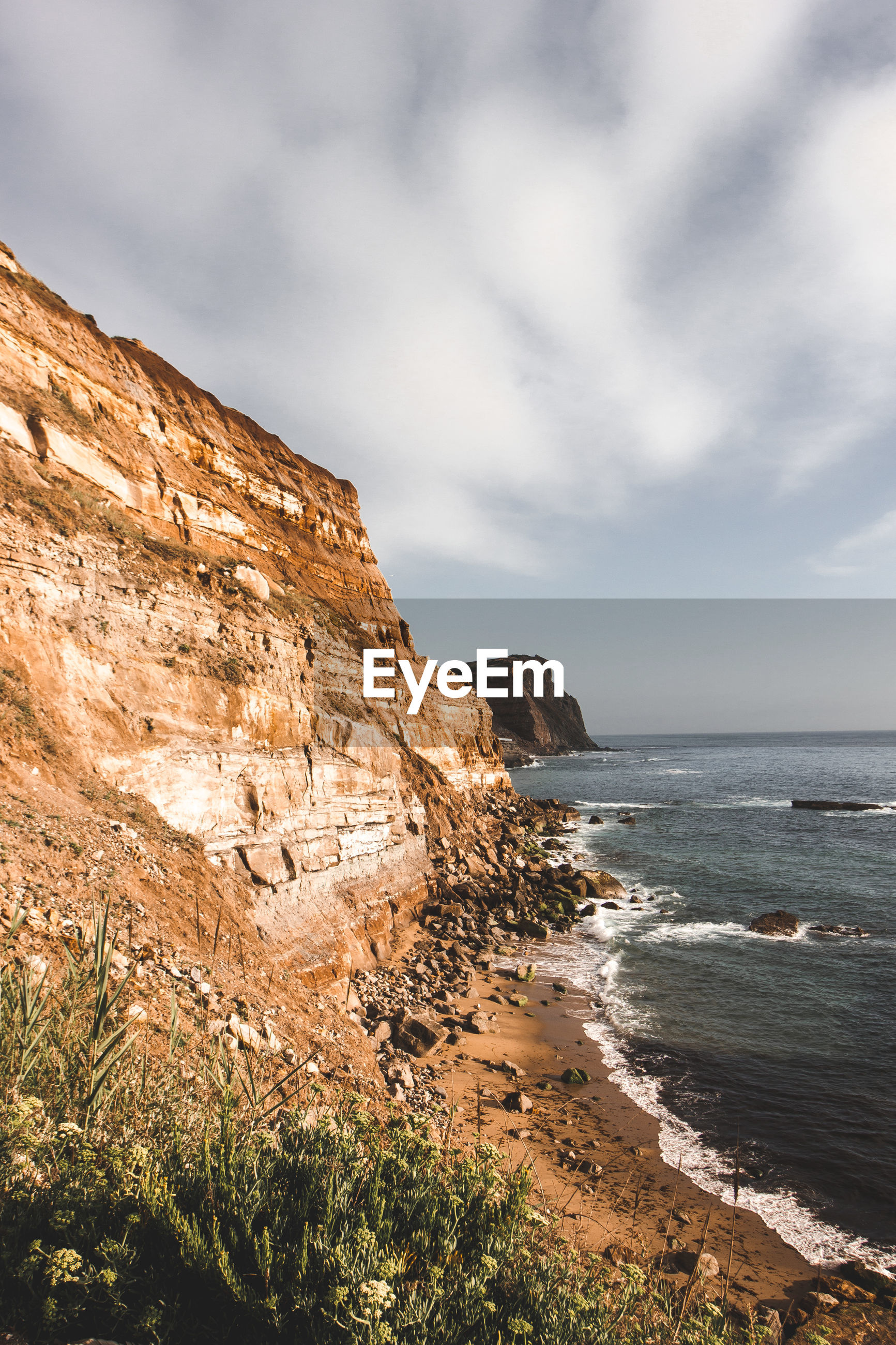 SCENIC VIEW OF ROCK FORMATIONS ON SEA AGAINST SKY