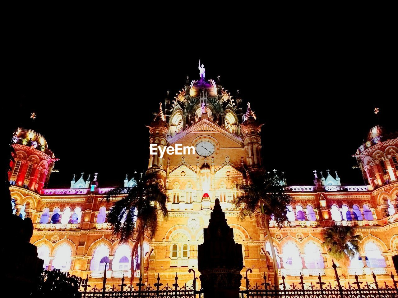 night, illuminated, architecture, building exterior, low angle view, built structure, religion, place of worship, outdoors, spirituality, travel destinations, arts culture and entertainment, sculpture, no people, clear sky, statue, sky, carousel