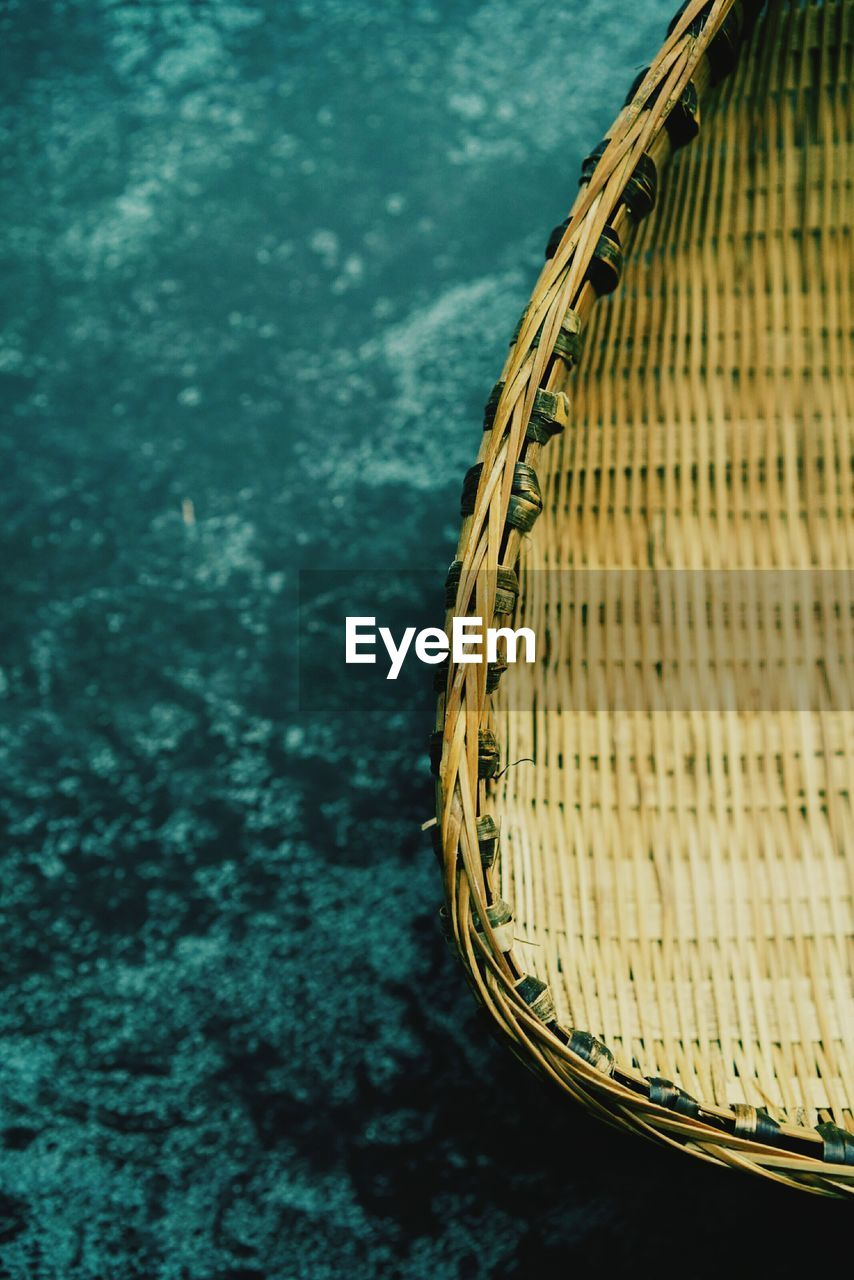 no people, water, nature, day, high angle view, close-up, yellow, focus on foreground, outdoors, river, selective focus, wicker, transportation, pattern, tranquility, basket, wood - material, plant
