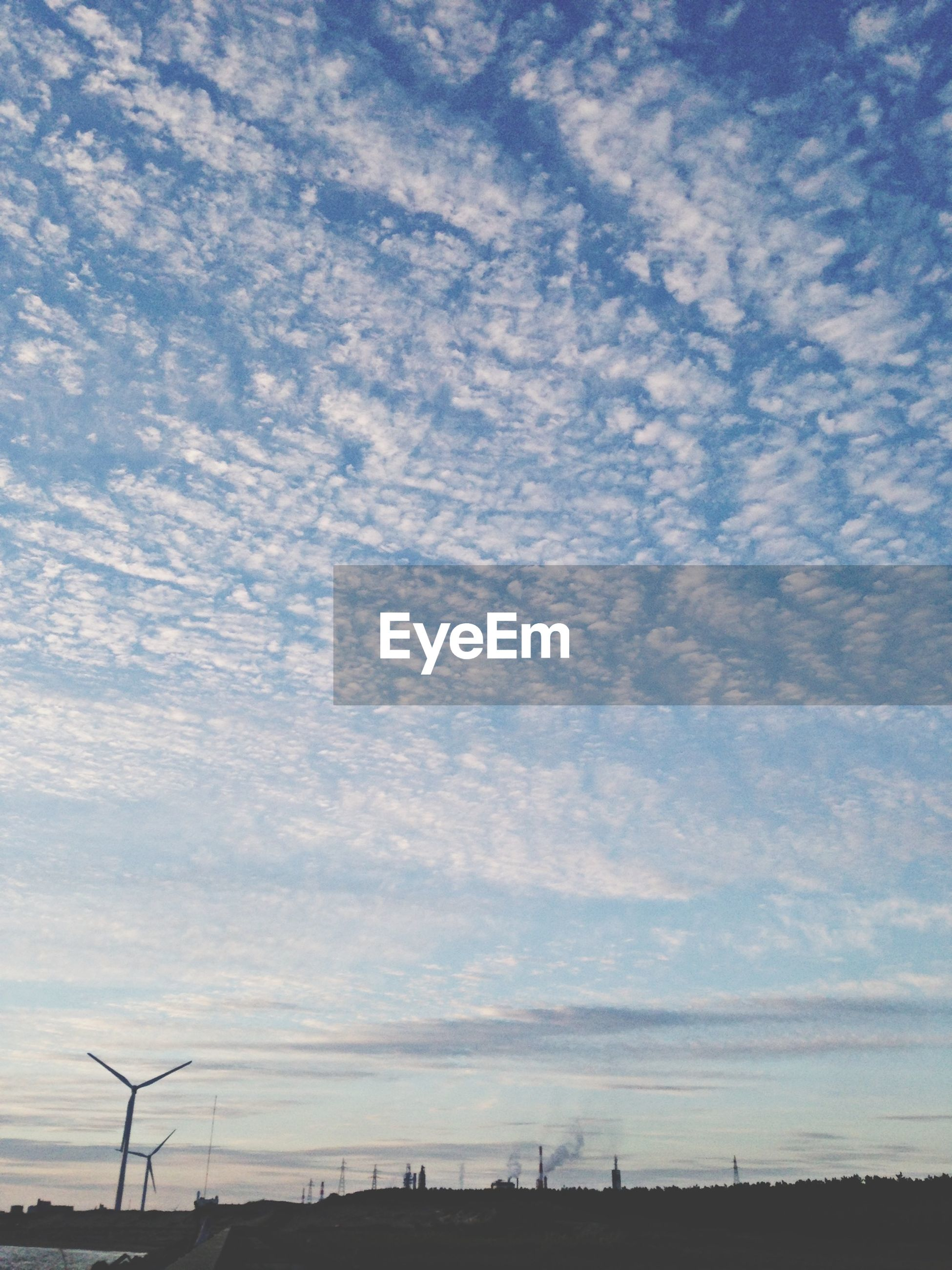 sky, cloud - sky, tranquility, tranquil scene, scenics, cloud, beauty in nature, nature, cloudy, landscape, low angle view, electricity pylon, fuel and power generation, blue, outdoors, connection, no people, field, silhouette, day