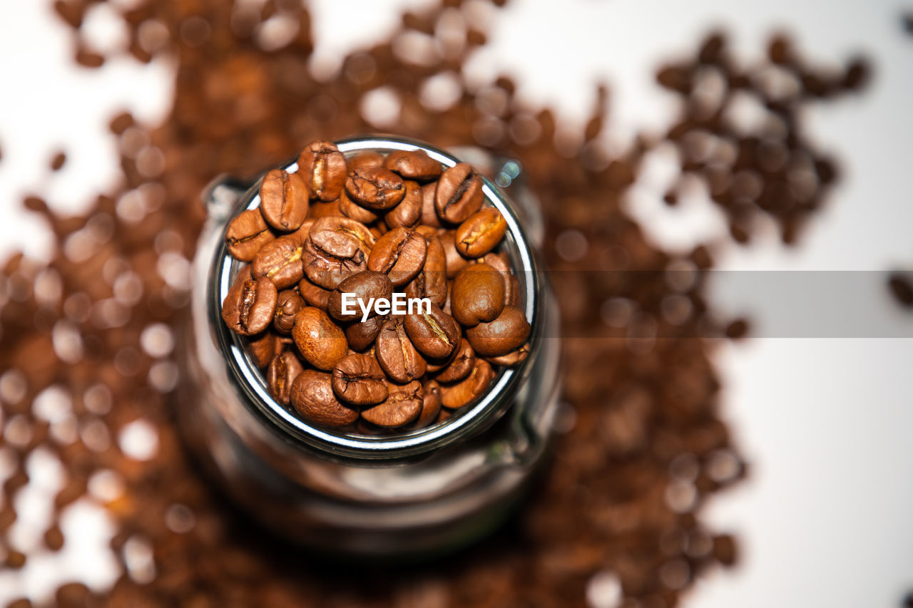 food and drink, food, indoors, coffee - drink, still life, close-up, coffee, roasted coffee bean, brown, freshness, selective focus, high angle view, table, no people, nut, container, nut - food, refreshment, focus on foreground, wellbeing, snack, temptation