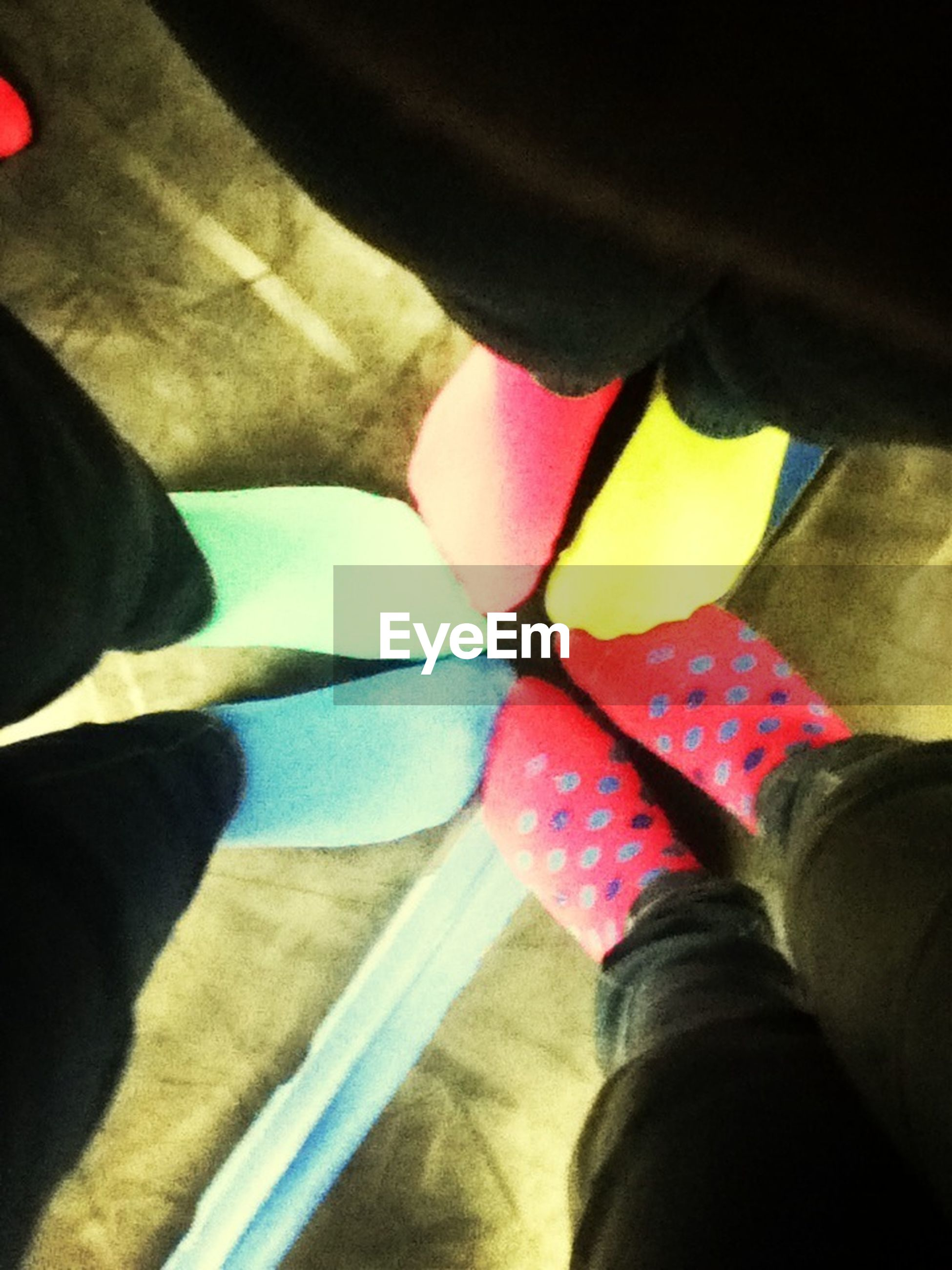 low section, person, lifestyles, personal perspective, part of, men, human foot, leisure activity, shoe, unrecognizable person, high angle view, standing, holding, multi colored