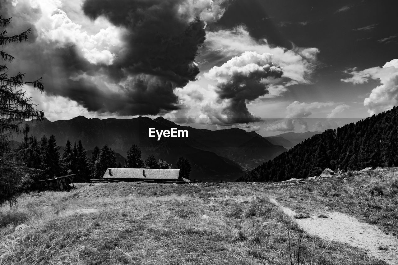 cloud - sky, mountain, sky, beauty in nature, scenics - nature, mountain range, nature, tranquil scene, tranquility, environment, no people, day, non-urban scene, landscape, tree, plant, land, outdoors, idyllic, ominous, mountain peak