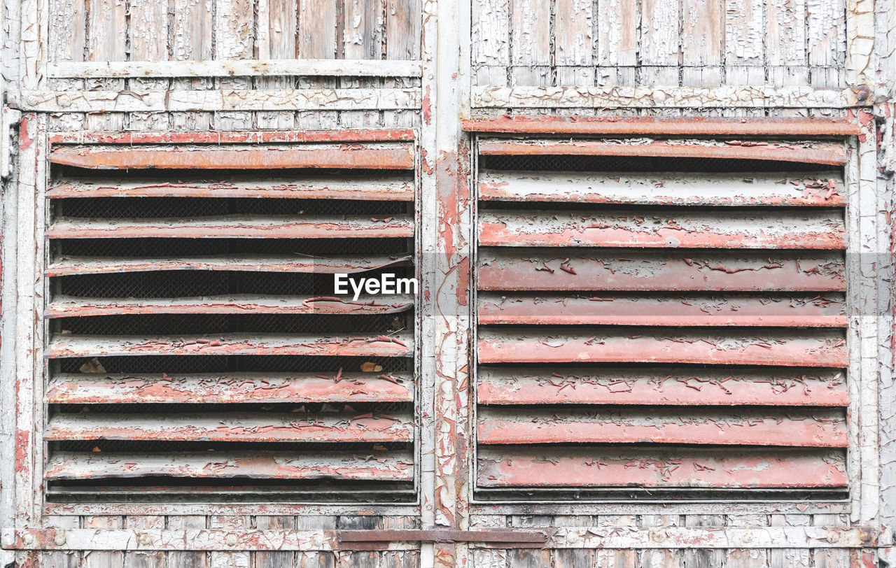 pattern, backgrounds, no people, full frame, day, architecture, old, built structure, metal, weathered, rusty, close-up, building exterior, wall - building feature, outdoors, wood - material, iron, shutter, textured, repetition, corrugated