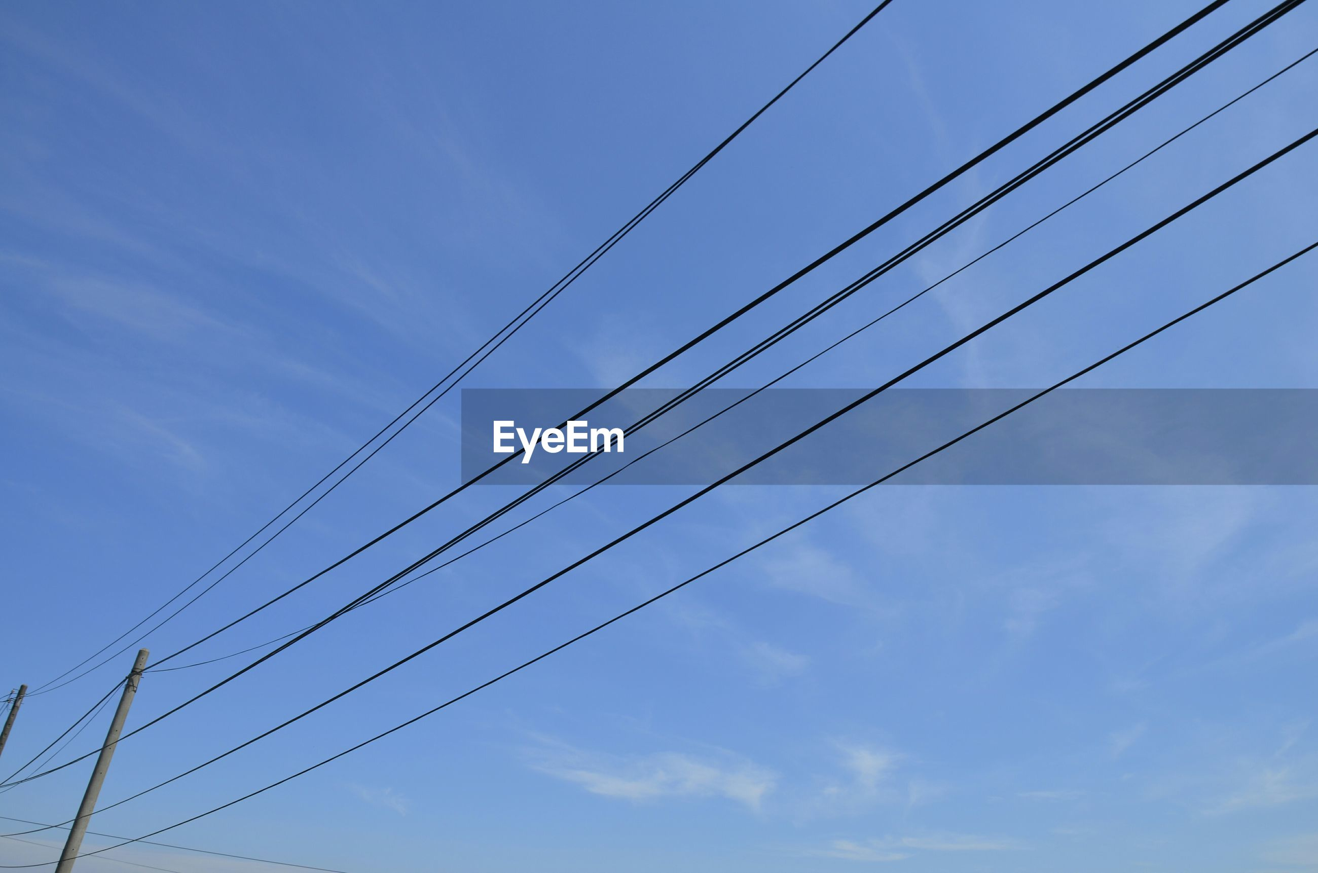 Low angle view of wires against sky