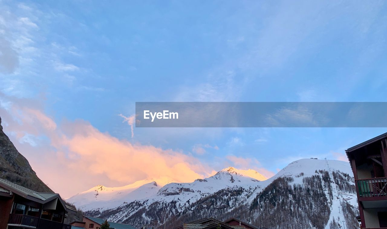 mountain, cold temperature, sky, snow, cloud - sky, winter, scenics - nature, beauty in nature, nature, architecture, built structure, building exterior, snowcapped mountain, mountain range, no people, tranquil scene, tranquility, day, environment, mountain peak