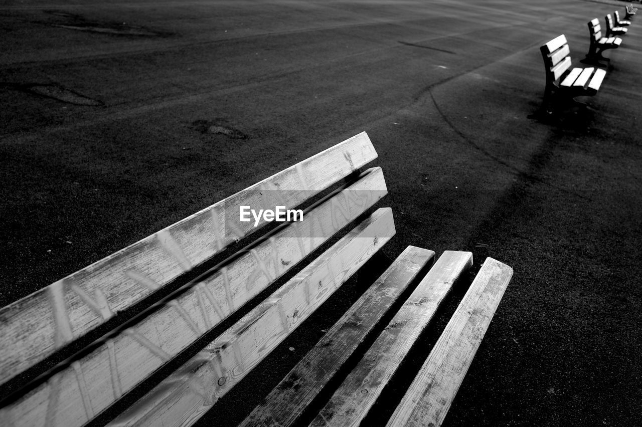 High angle view of empty bench on road