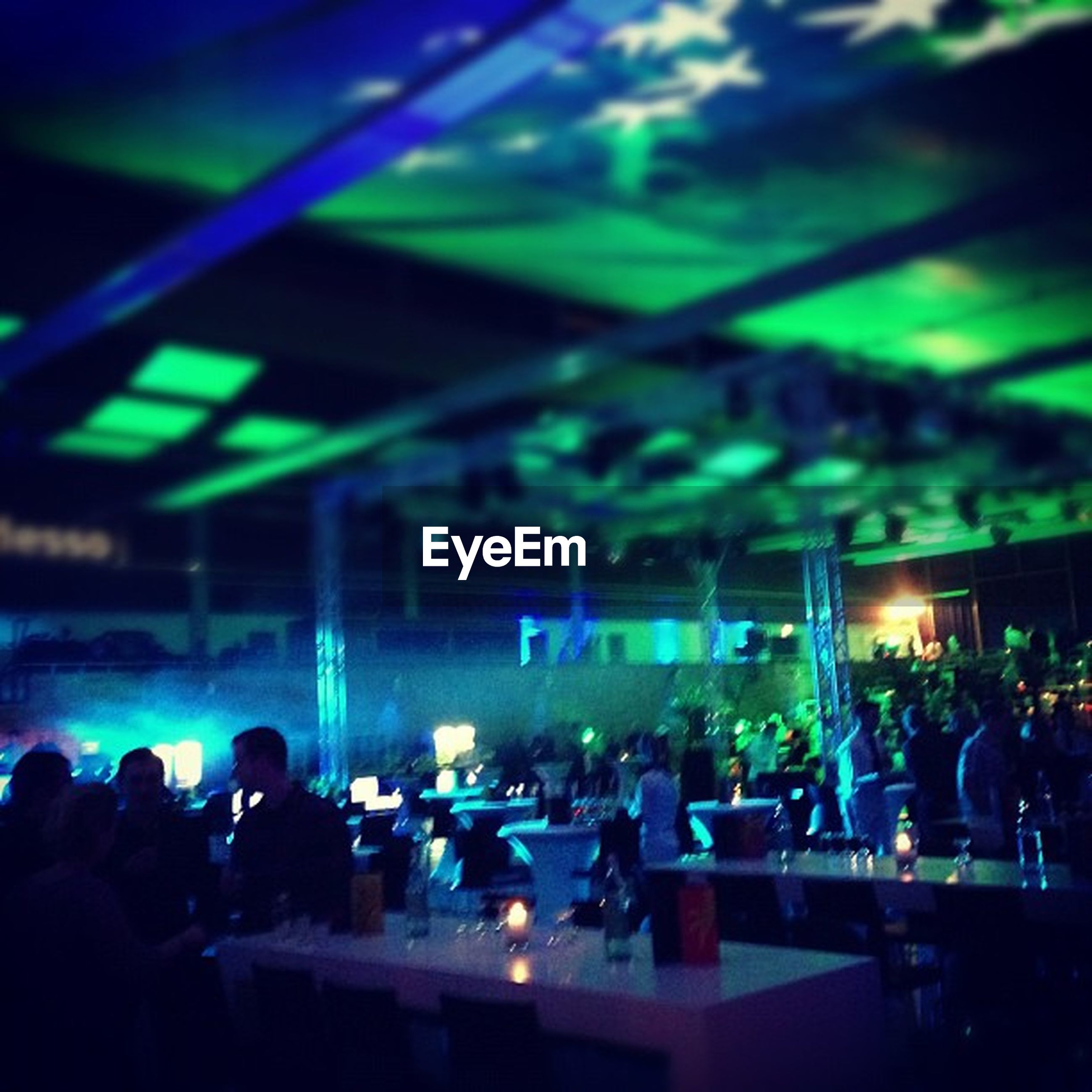 large group of people, illuminated, crowd, night, person, lifestyles, enjoyment, nightlife, men, arts culture and entertainment, music, leisure activity, performance, indoors, fun, event, stage - performance space, music festival