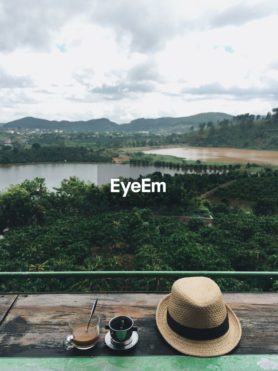 hat, water, tree, sky, river, day, no people, table, nature, mountain, outdoors, drinking glass, drink, scenics, beauty in nature