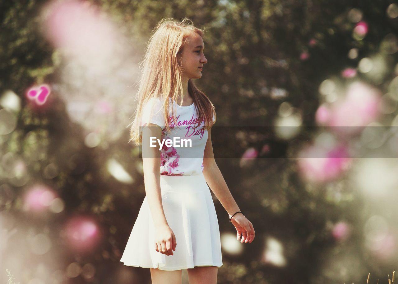 Young Girl Standing In Garden