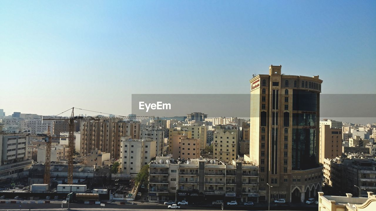 architecture, building exterior, built structure, cityscape, city, no people, skyscraper, outdoors, residential building, day, clear sky, sky