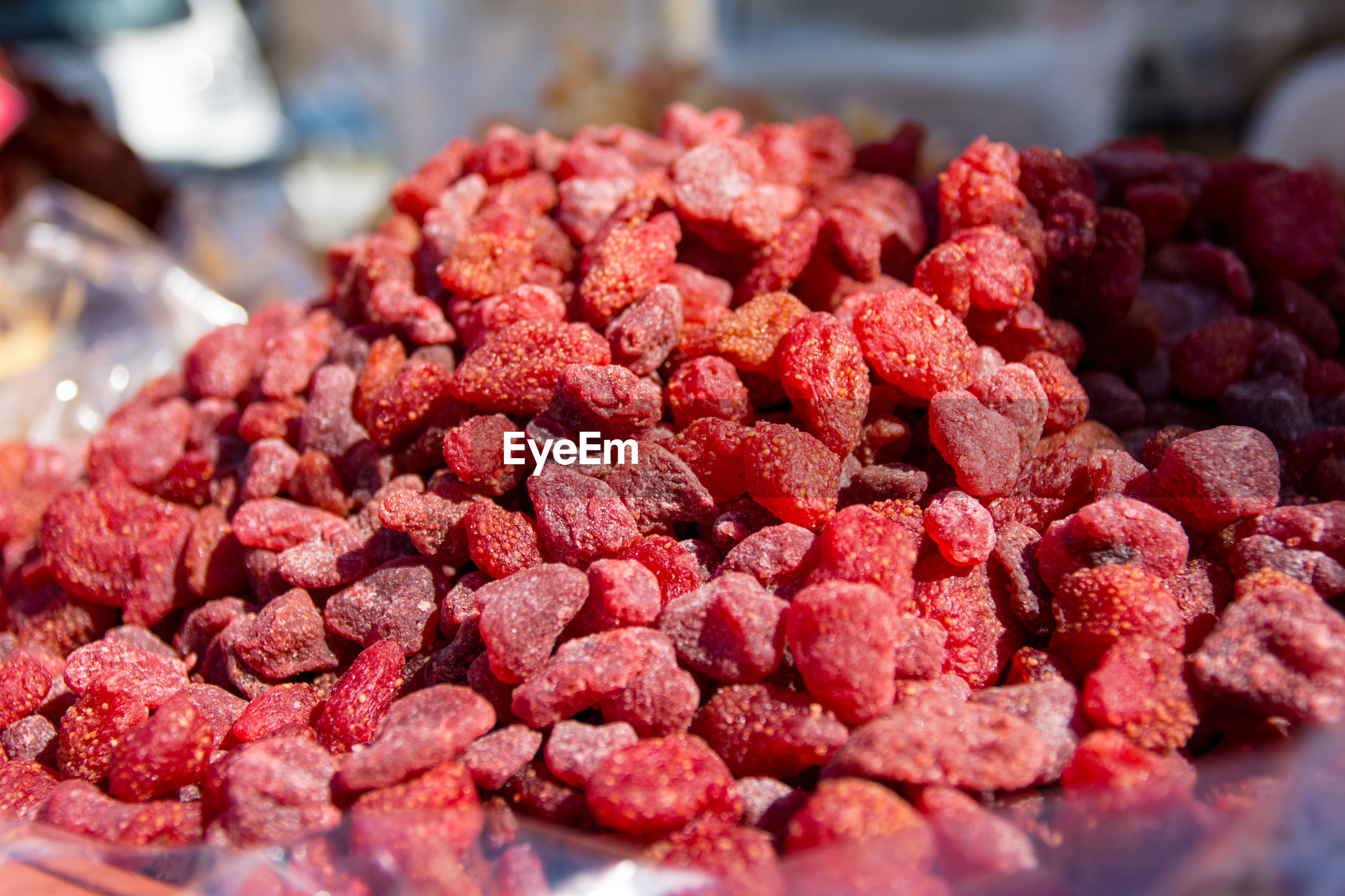 Close-up of dried strawberries for sale at market stall