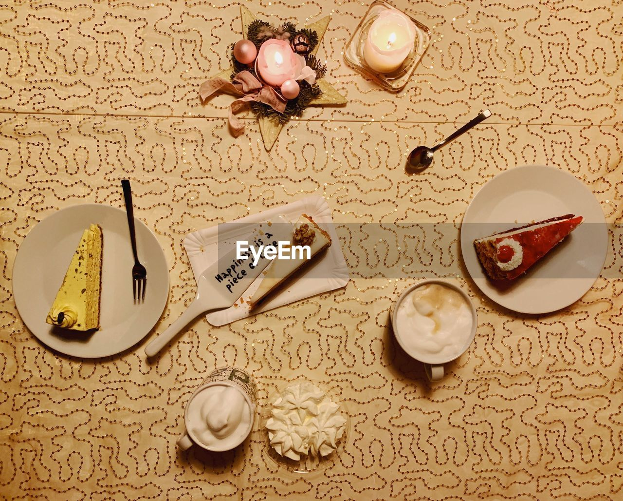 food, food and drink, still life, table, indoors, no people, freshness, high angle view, pattern, candle, large group of objects, text, plate, eating utensil, spoon, kitchen utensil, directly above, communication, drink, healthy eating, floral pattern