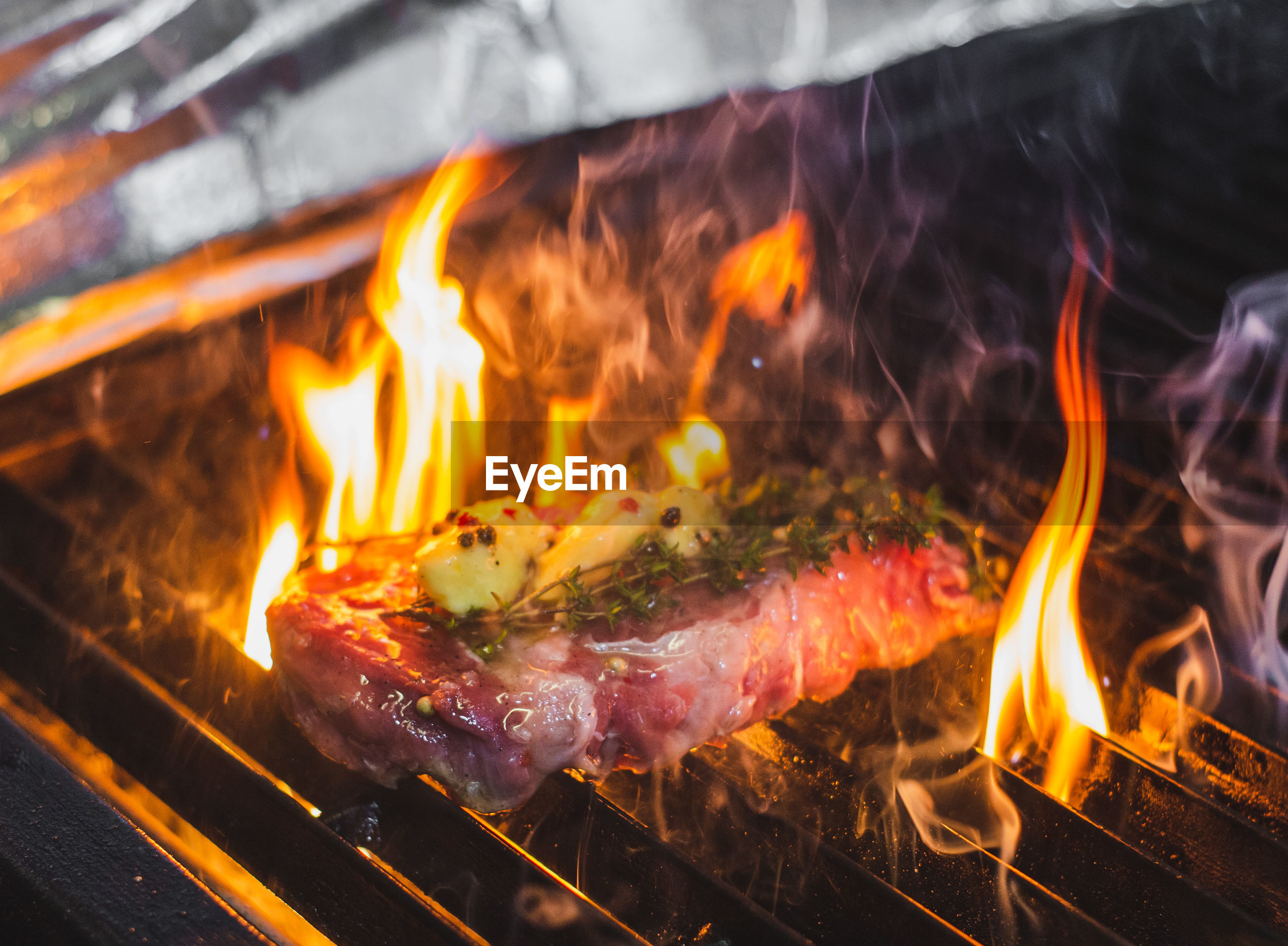 Close-up of steak on barbecue grill