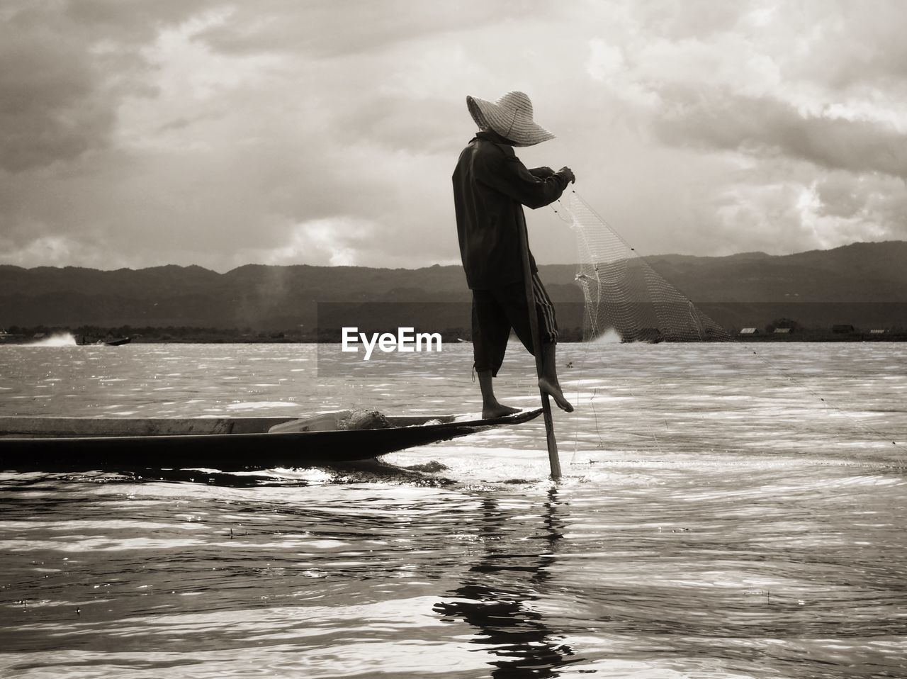 Full length of man standing on boat