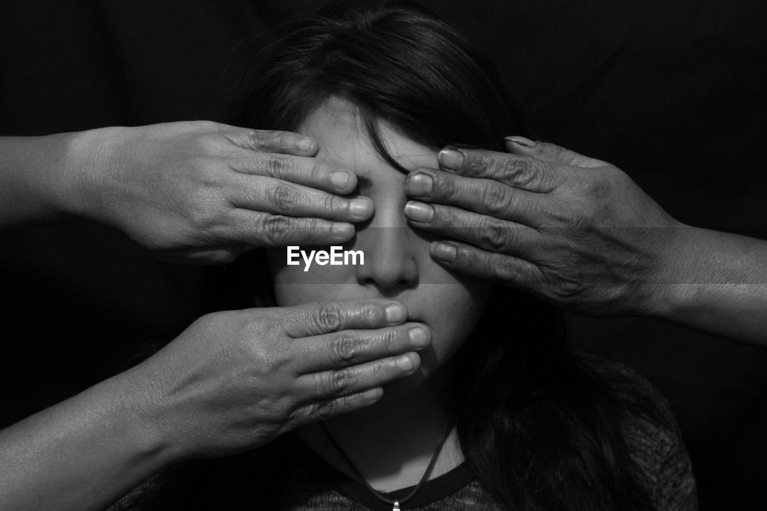 Close-up of a hands on woman's face