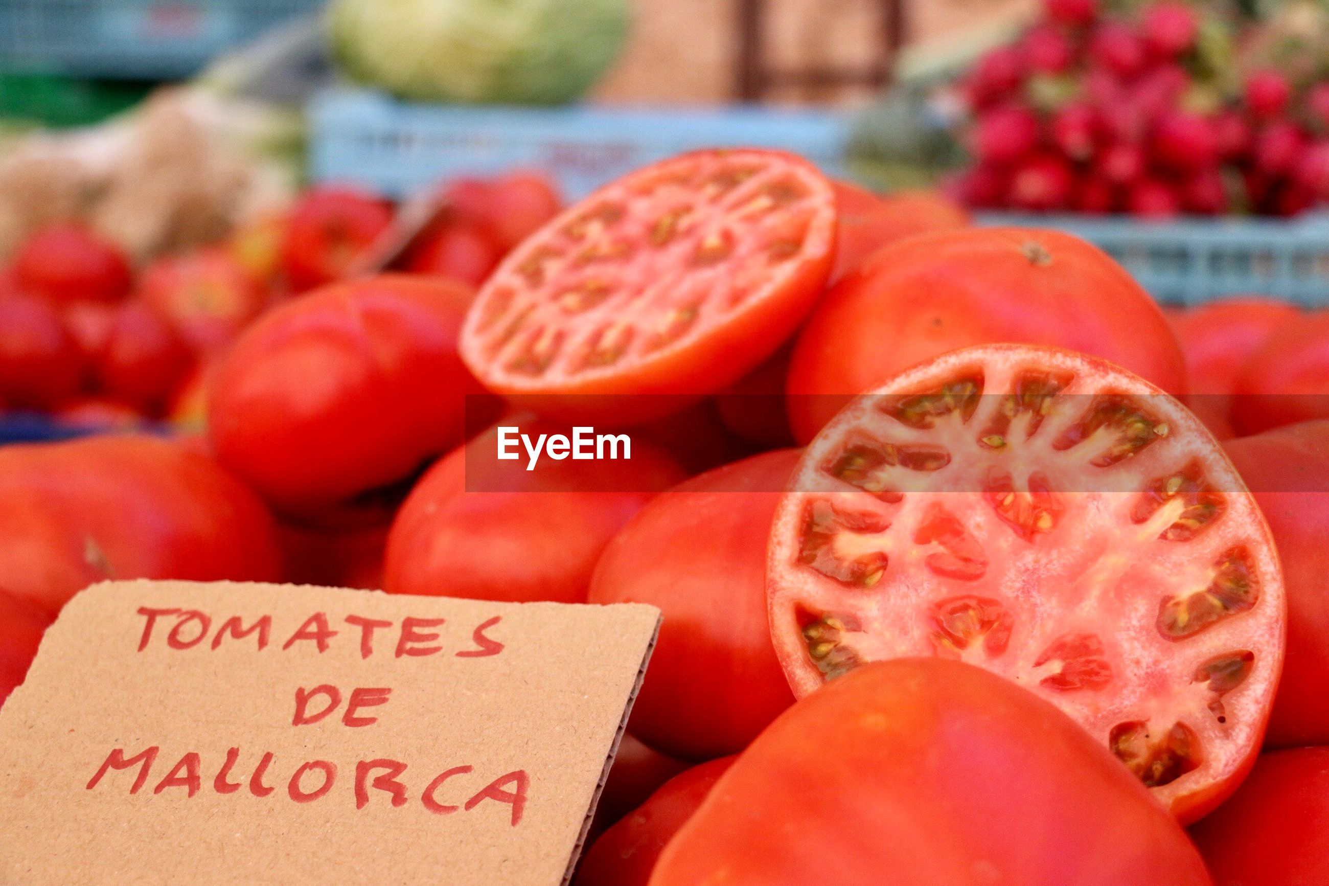 Close-up of fresh tomatoes for sale at market stall