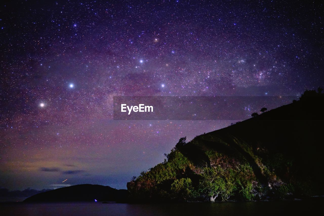 night, star - space, beauty in nature, sky, scenics - nature, space, astronomy, water, tranquility, tranquil scene, nature, no people, galaxy, star, star field, mountain, outdoors, idyllic, constellation, milky way, purple