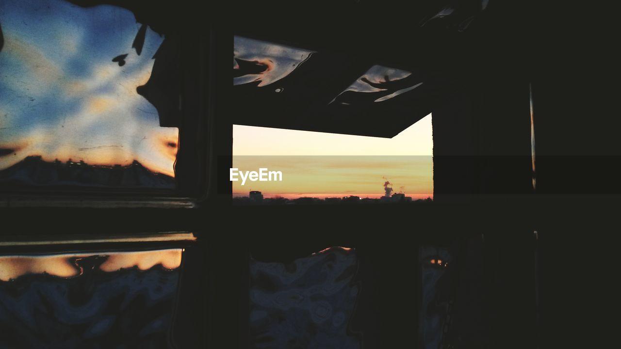 Scenic view of orange sky seen through home window
