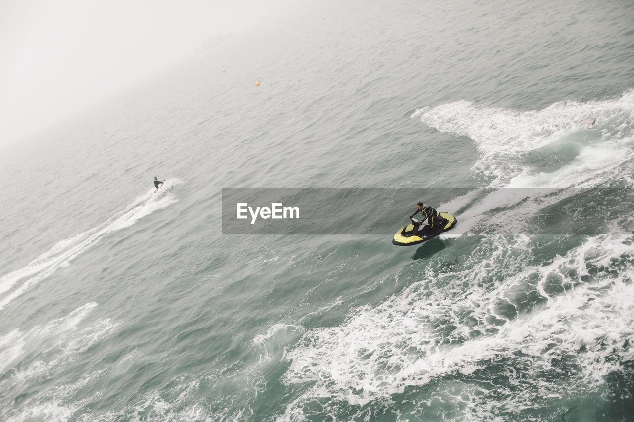 High Angle Of Man Jet Boating At Sea