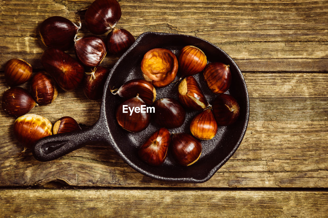 food and drink, food, wood - material, table, still life, freshness, healthy eating, wellbeing, indoors, directly above, no people, high angle view, brown, chestnut - food, nut, chestnut, nut - food, bowl, close-up, large group of objects