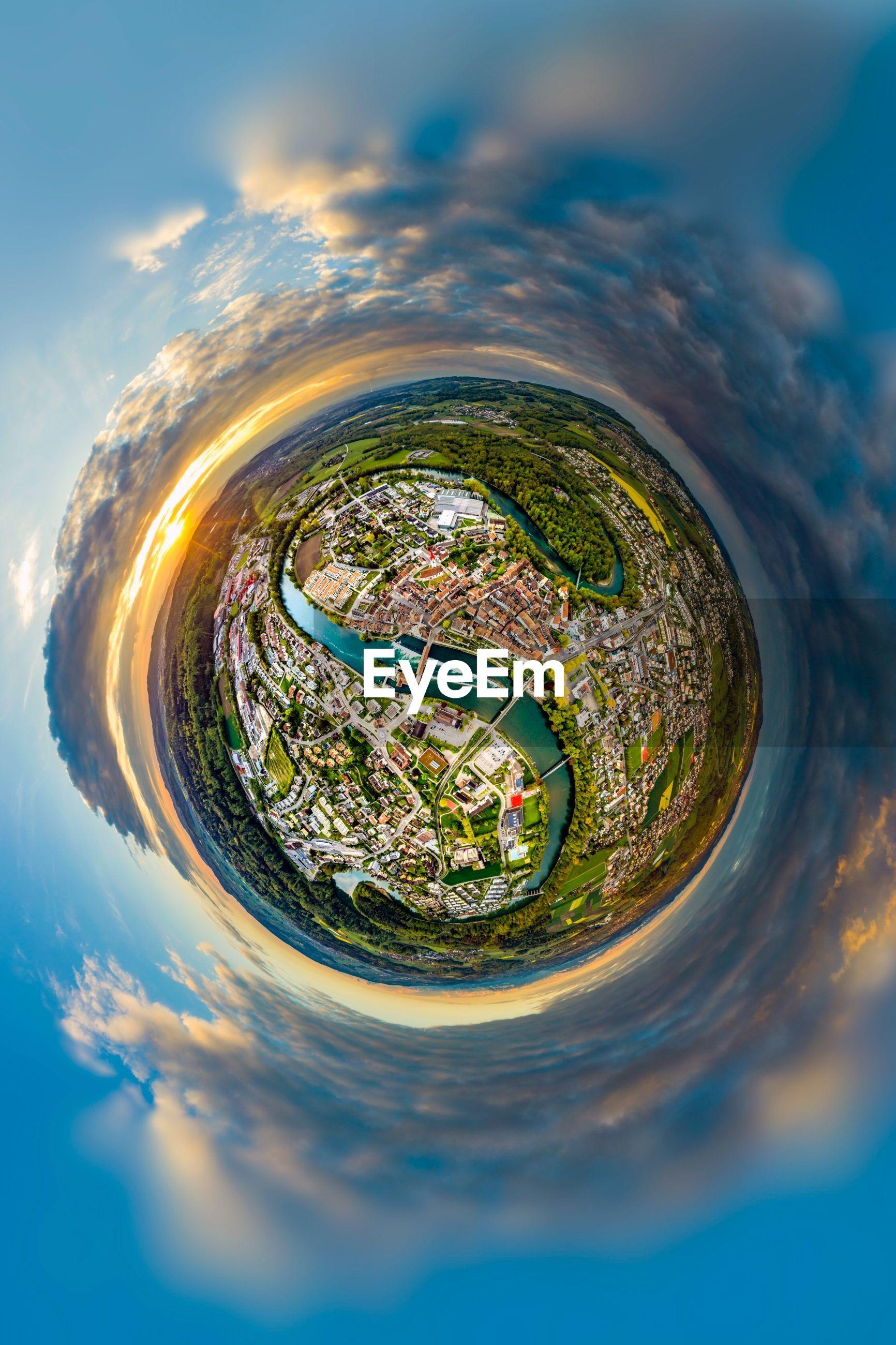 Little planet format of cityscape against sky