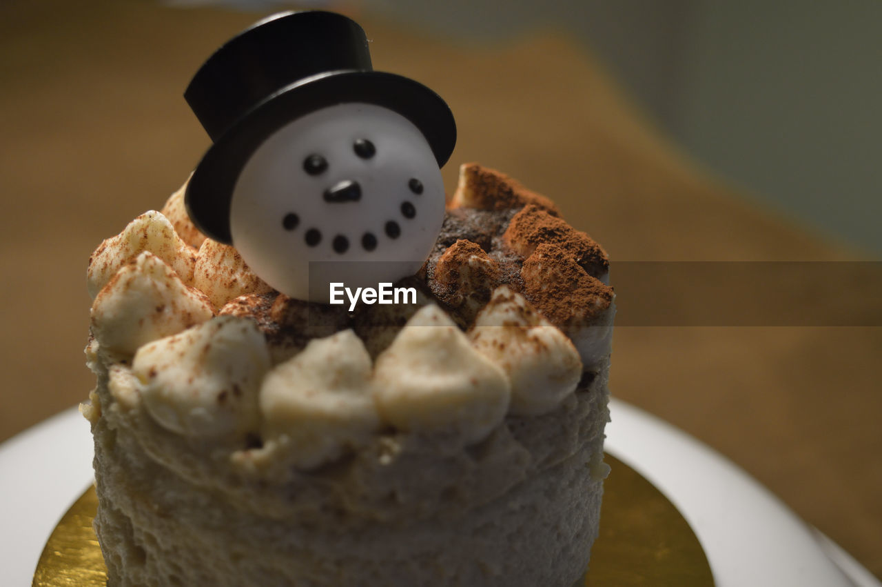 Close-Up Of Dessert With Snowman