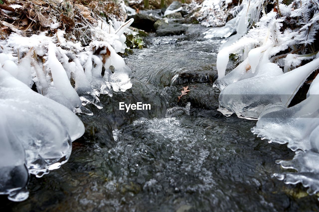 water, cold temperature, nature, snow, rock, frozen, winter, rock - object, day, solid, motion, no people, beauty in nature, ice, outdoors, white color, river, flowing water, flowing, stream - flowing water
