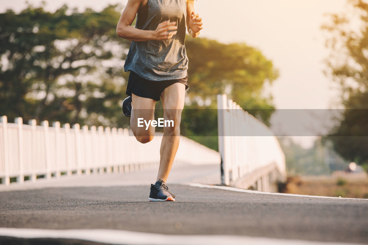 lifestyles, one person, real people, day, leisure activity, sport, road, nature, architecture, casual clothing, exercising, shorts, human leg, city, healthy lifestyle, running, shoe, clothing, motion, outdoors