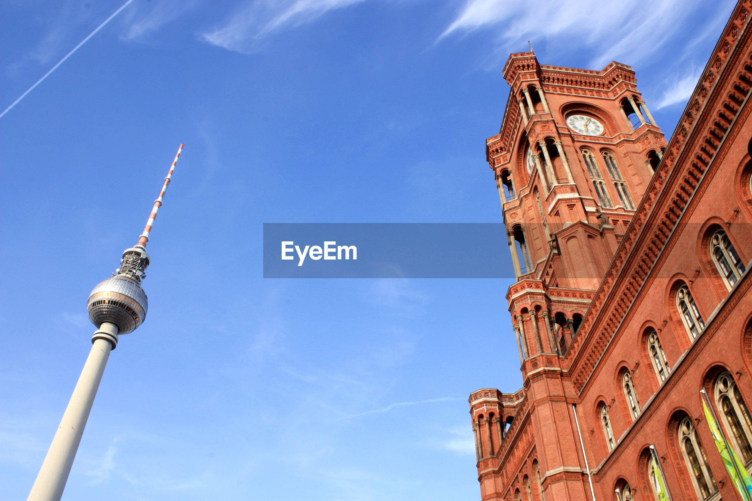 Low angle view of rotes rathaus and fernsehturm against sky