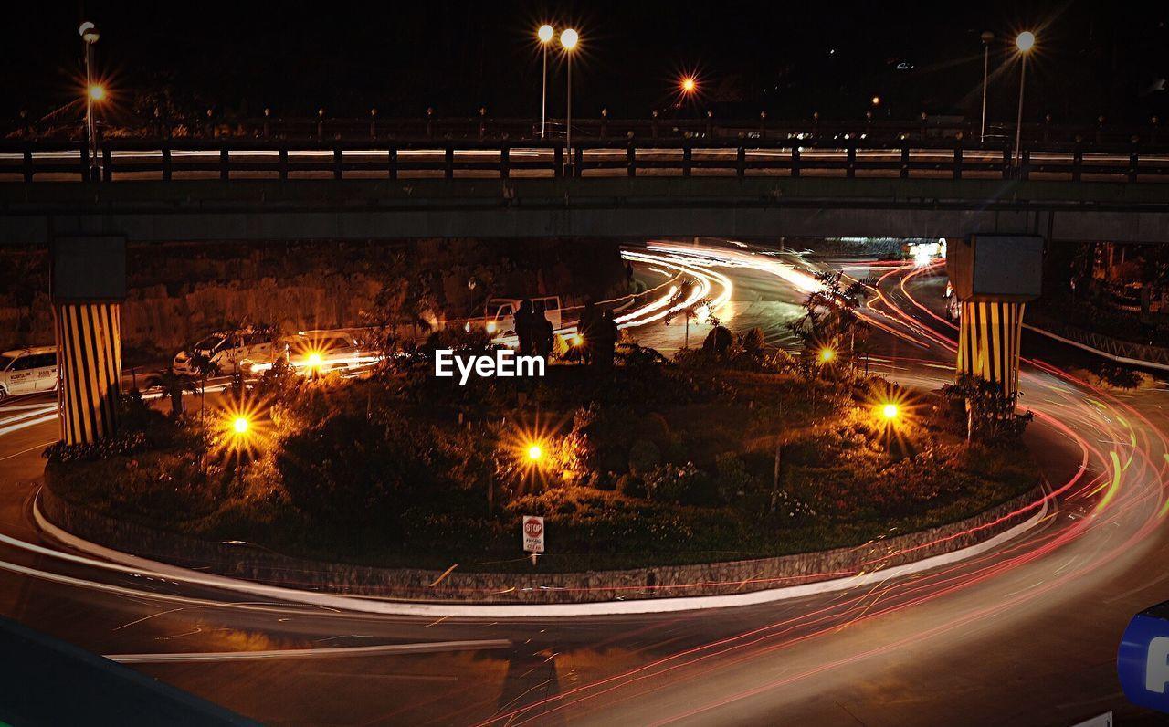 illuminated, night, long exposure, light trail, speed, motion, road, street light, blurred motion, high street, transportation, outdoors, city, no people