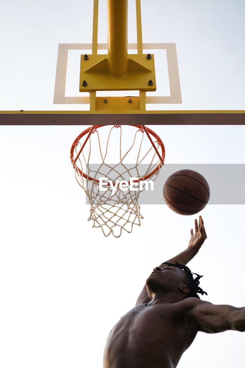 Black man playing basketball game