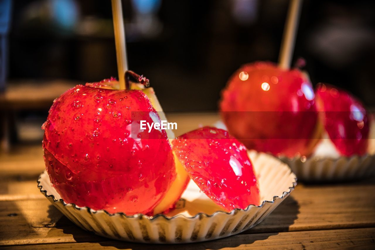 food and drink, food, red, freshness, fruit, table, close-up, sweet food, healthy eating, still life, indoors, focus on foreground, indulgence, temptation, sweet, ready-to-eat, wood - material, dessert, no people, snack