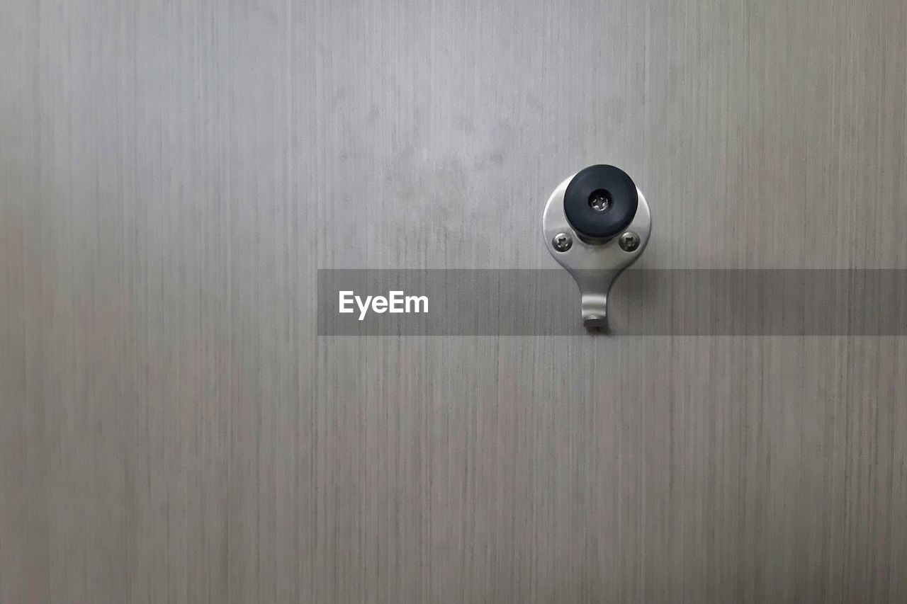 wall - building feature, technology, no people, indoors, security camera, metal, close-up, surveillance, security, control, safety, wood - material, protection, day, built structure, gray, silver colored, architecture, copy space, door