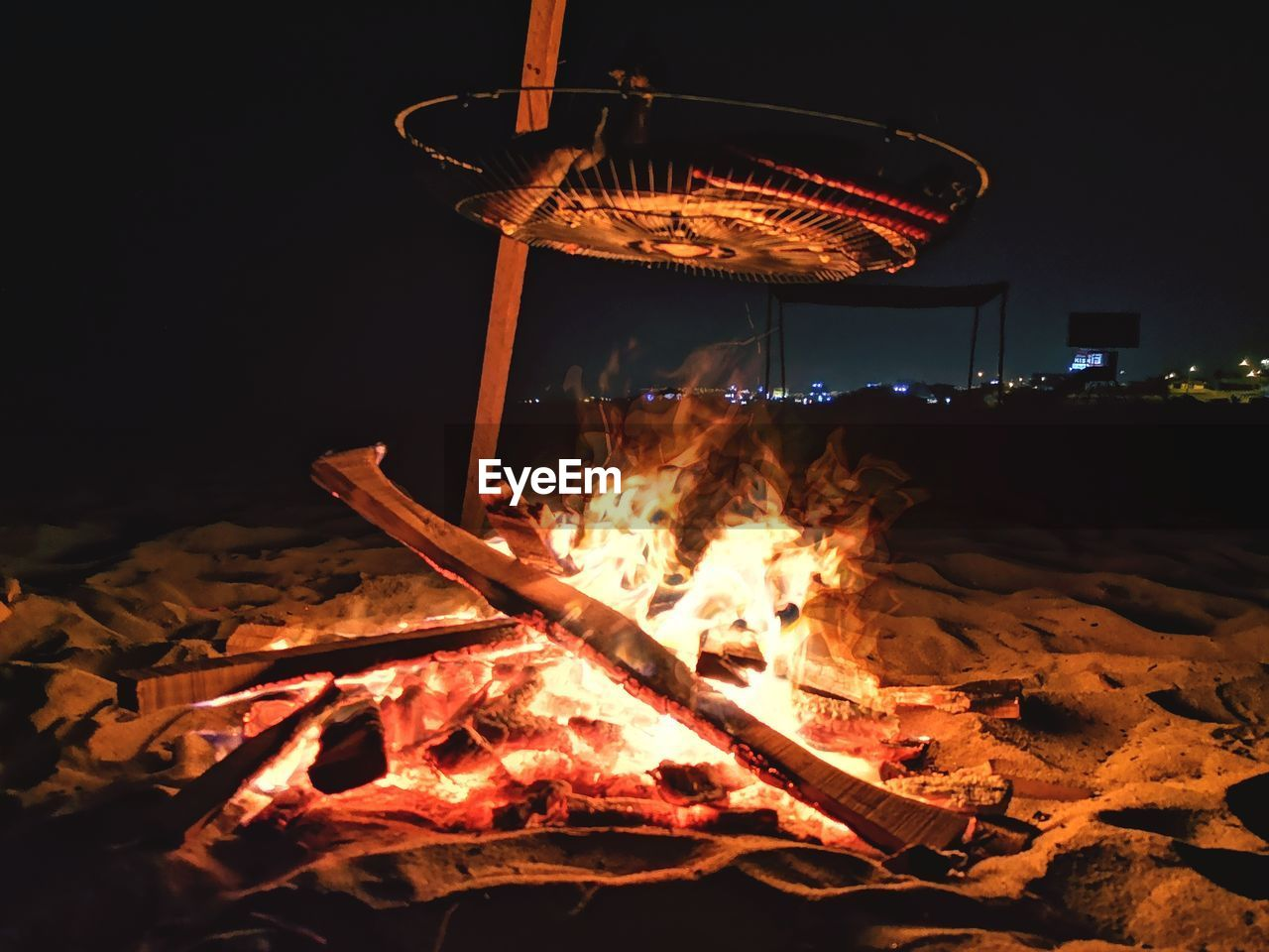 BONFIRE AGAINST FIRE AT NIGHT