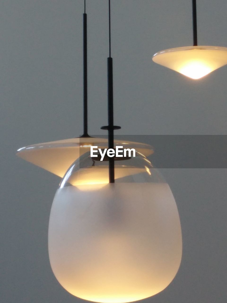 illuminated, lighting equipment, electricity, indoors, light, pendant light, electric lamp, glowing, hanging, no people, close-up, light bulb, electric light, light - natural phenomenon, ceiling, decoration, technology, metal, shape, table, light fixture, electrical equipment