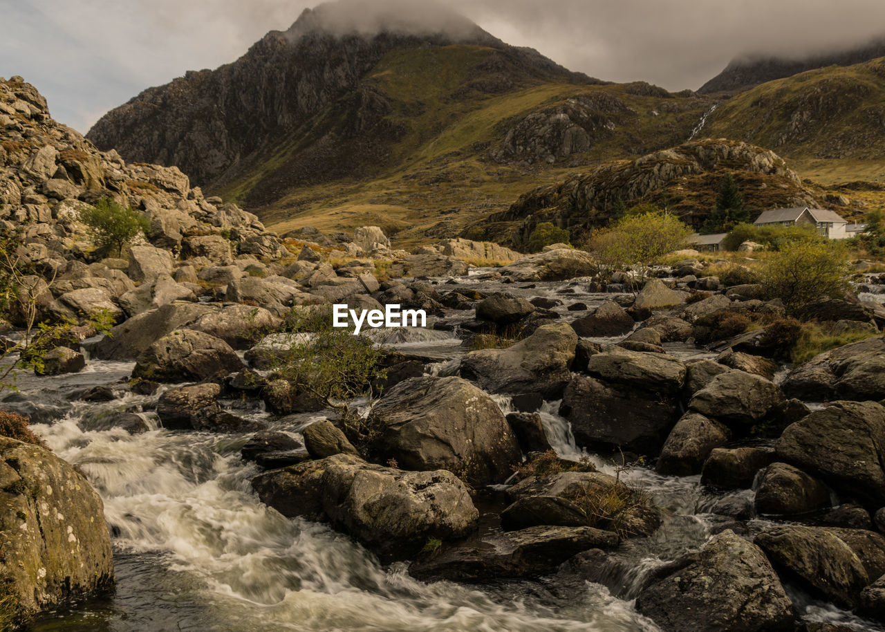 rock, mountain, solid, beauty in nature, rock - object, scenics - nature, water, no people, nature, tranquil scene, tranquility, mountain range, sky, day, environment, non-urban scene, river, outdoors, motion, flowing water, flowing