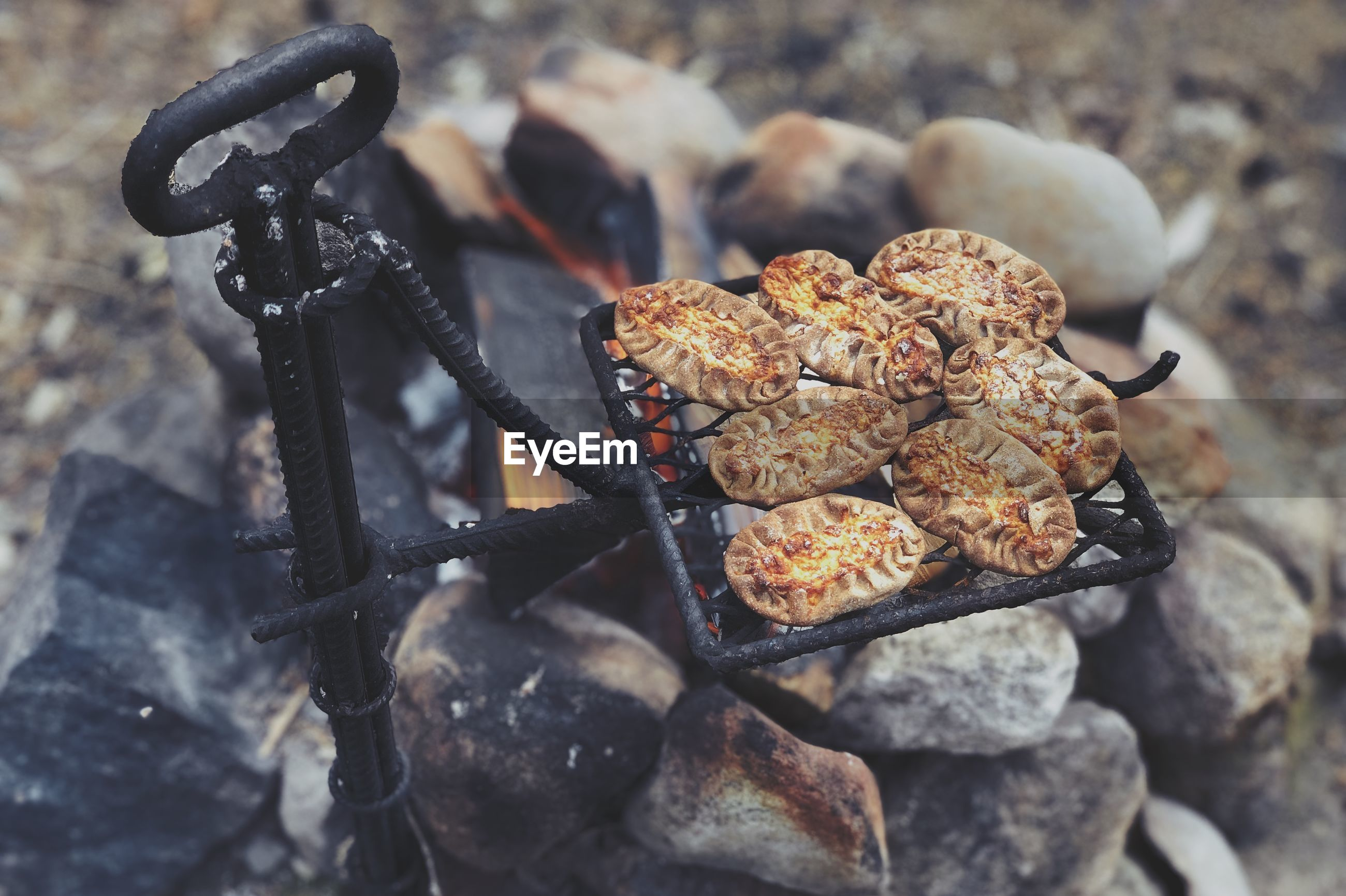 High angle view of food cooking over campfire