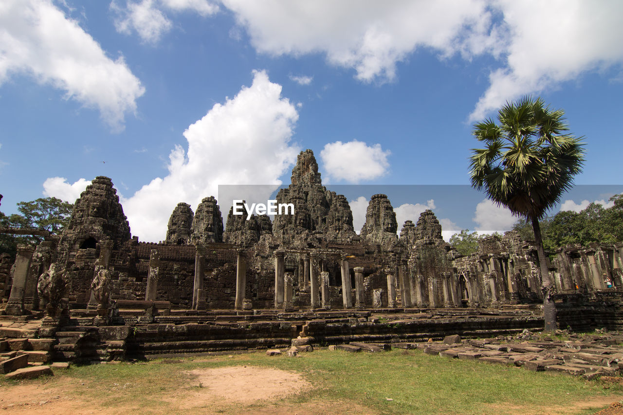 history, the past, ancient, sky, architecture, cloud - sky, place of worship, ancient civilization, religion, built structure, old ruin, travel destinations, tourism, spirituality, travel, belief, nature, day, archaeology, no people, ruined, outdoors, ancient history