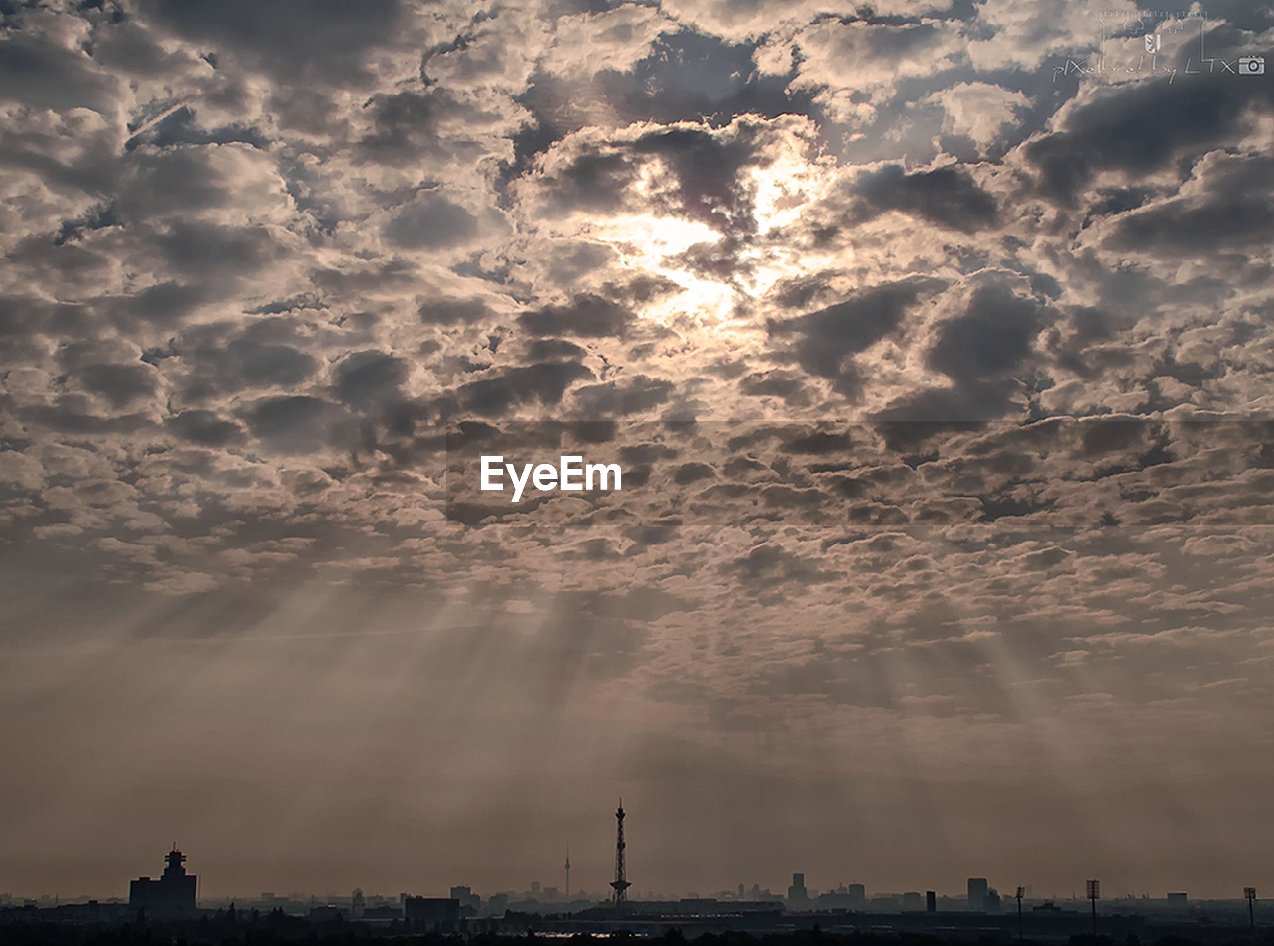 sky, cloud - sky, city, built structure, weather, architecture, building exterior, sunbeam, cityscape, cloudy, cloud, tourism, travel destinations, dramatic sky, nature, atmospheric mood, development, tranquility, beauty in nature, city life, vacations, day, atmosphere, scenics, cloudscape, storm cloud, outdoors, majestic, tranquil scene