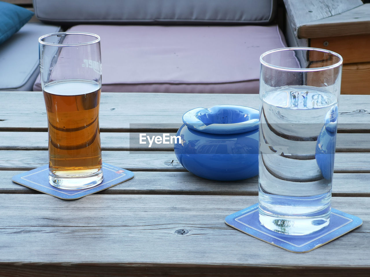 table, drink, drinking glass, food and drink, refreshment, glass, household equipment, still life, blue, freshness, close-up, wood - material, no people, indoors, water, day, drinking water, transparent, alcohol, crockery, tray