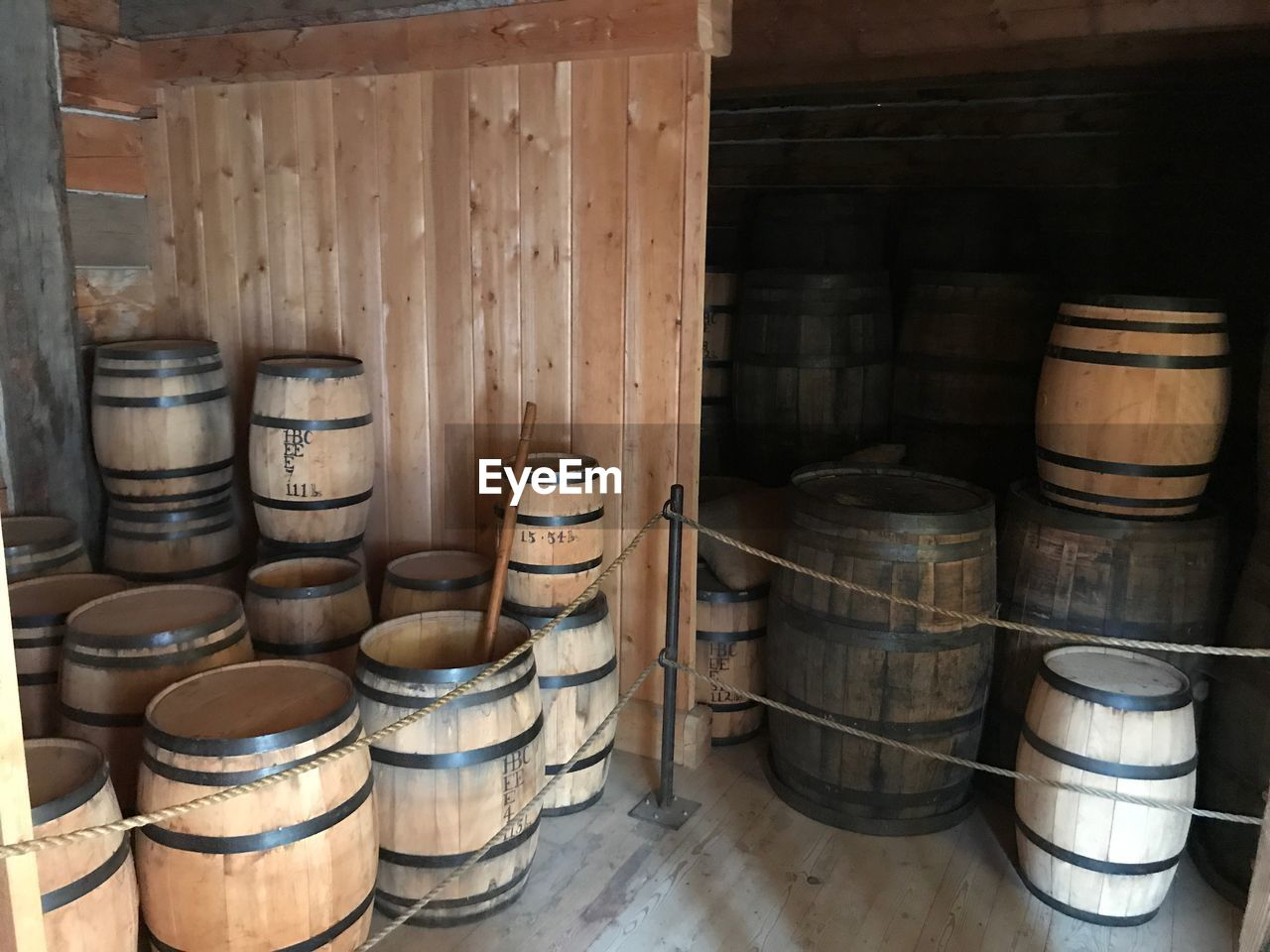 barrel, container, wine cask, indoors, cylinder, wood - material, cellar, domestic room, no people, winery, stack, food and drink, drink, refreshment, food and drink industry, wine cellar, wine, still life, large group of objects, alcohol, winemaking, distillation