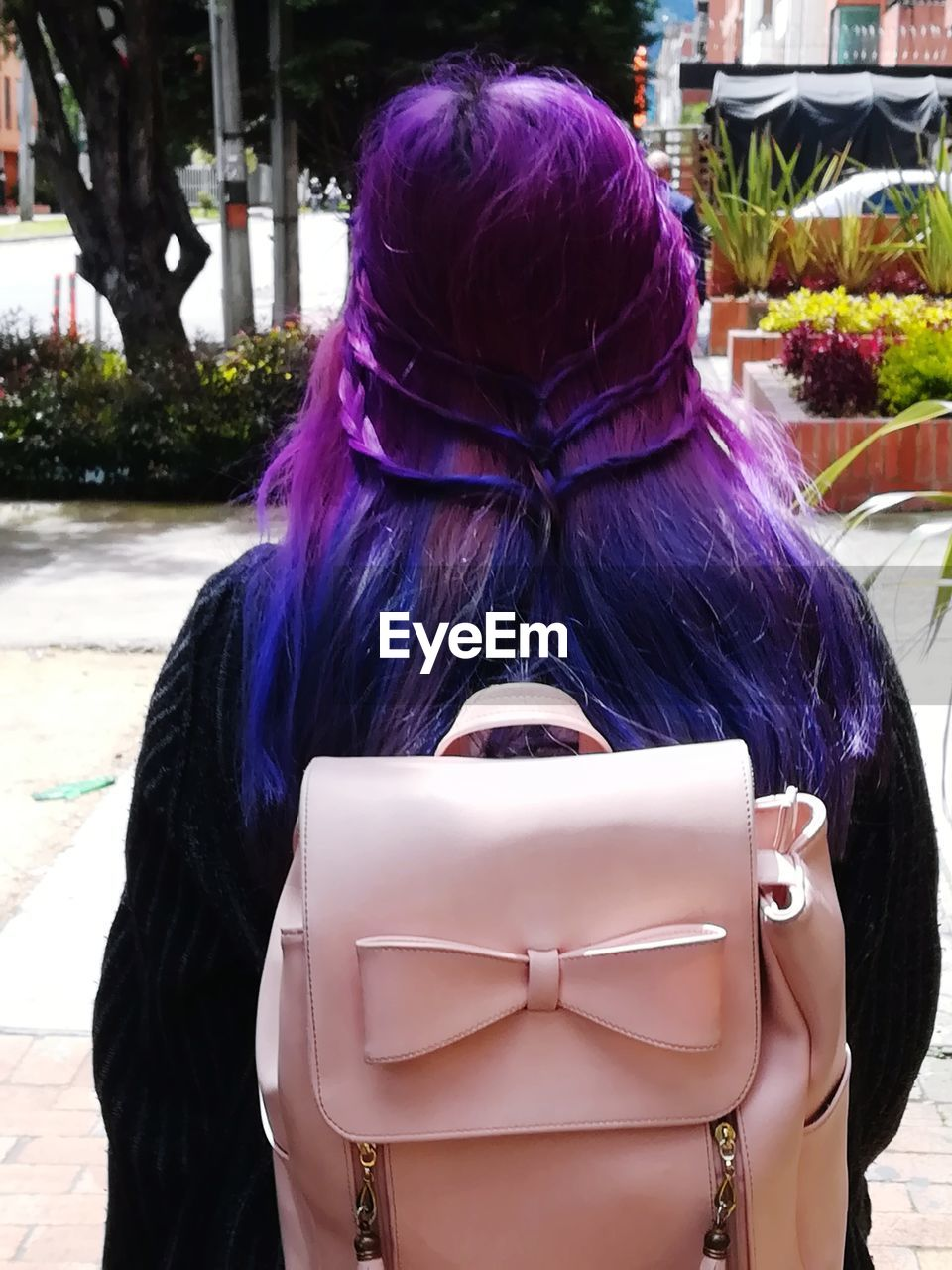 real people, rear view, one person, hairstyle, focus on foreground, day, hair, women, clothing, leisure activity, human representation, lifestyles, adult, wig, representation, city, close-up, long hair, outdoors, purple, warm clothing, dyed hair