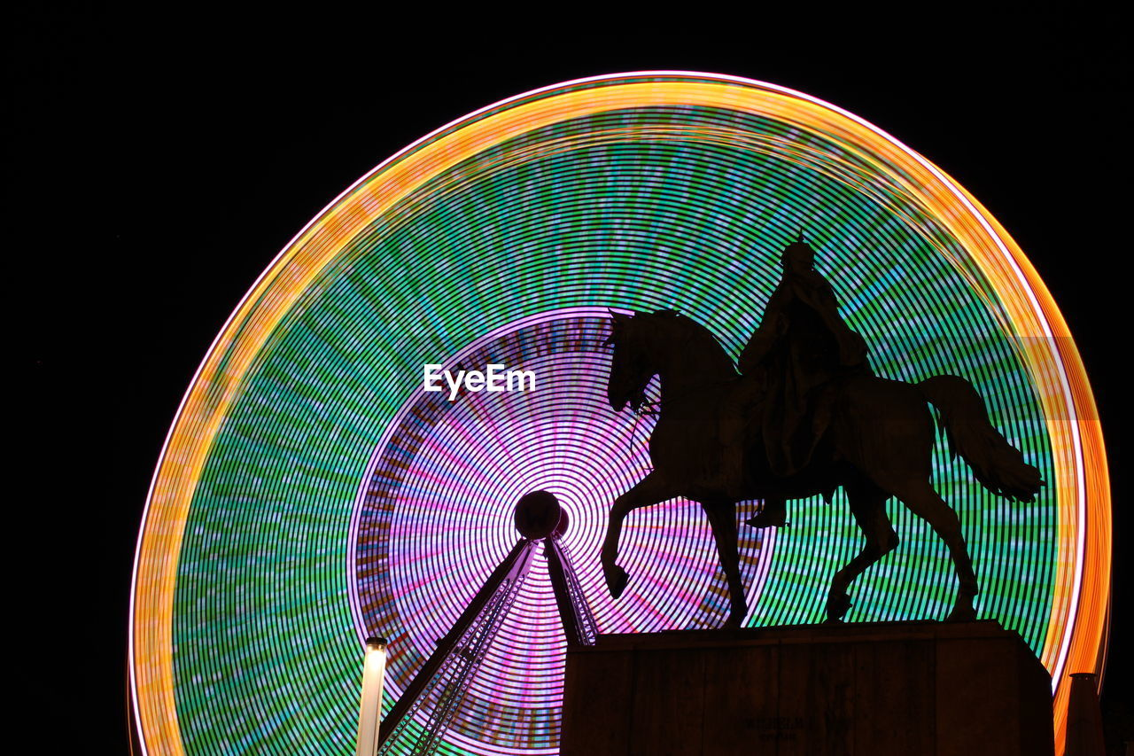 night, amusement park, illuminated, arts culture and entertainment, amusement park ride, silhouette, speed, carousel, multi colored, outdoors, no people, sky