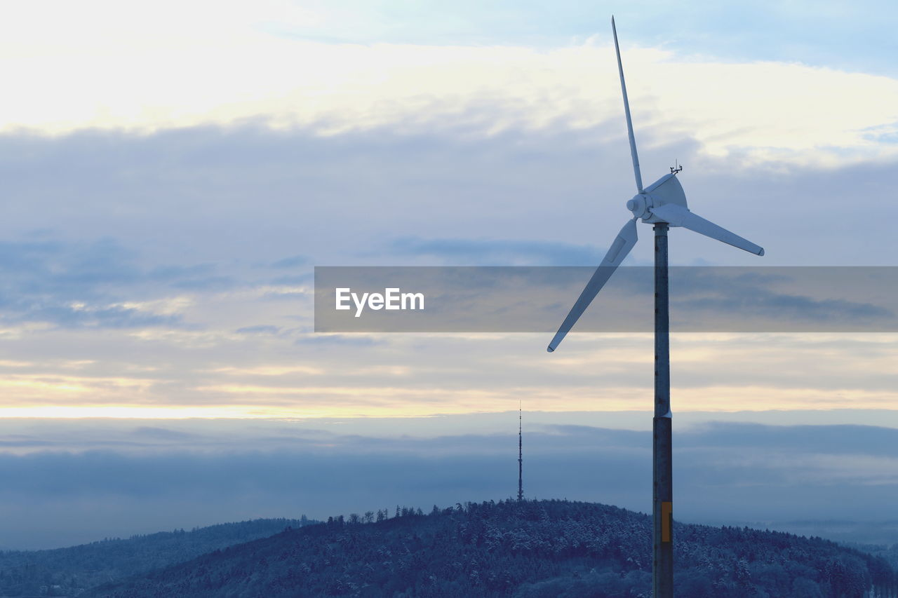 sky, fuel and power generation, renewable energy, alternative energy, cloud - sky, turbine, wind turbine, environment, wind power, environmental conservation, sunset, nature, beauty in nature, technology, scenics - nature, no people, landscape, outdoors, orange color, mountain, power in nature, sustainable resources, power supply
