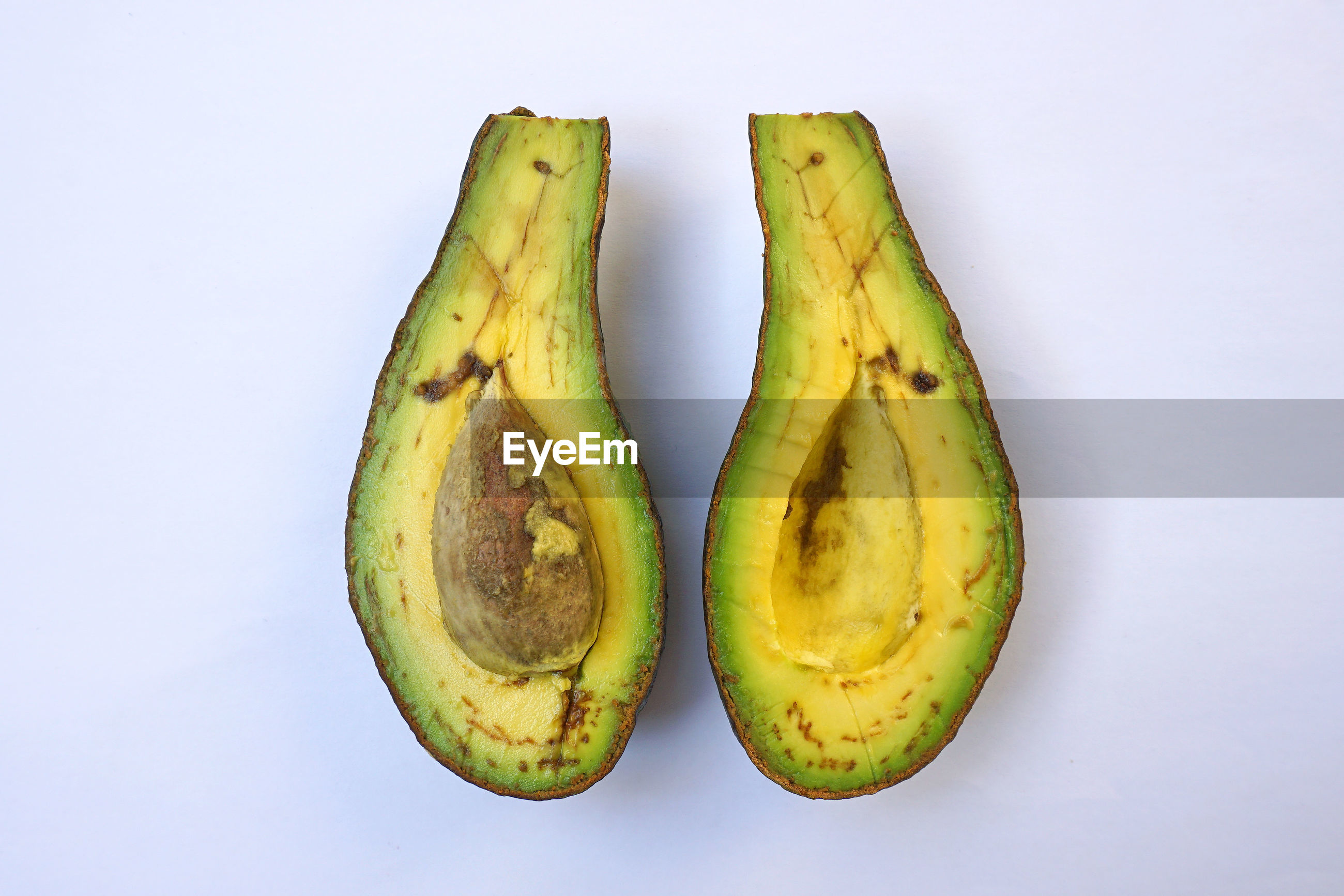 Directly above shot of avocado against white background