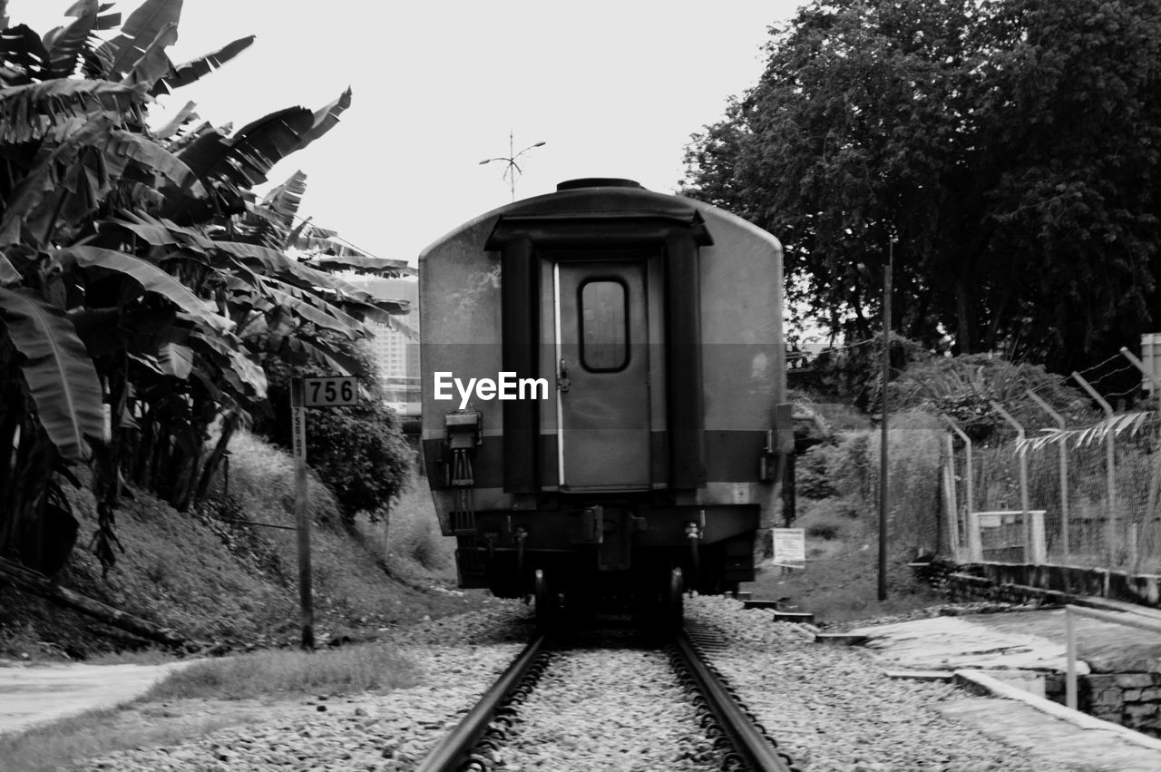 railroad track, transportation, rail transportation, mode of transport, train - vehicle, public transportation, tree, day, outdoors, the way forward, no people, nature, locomotive, sky