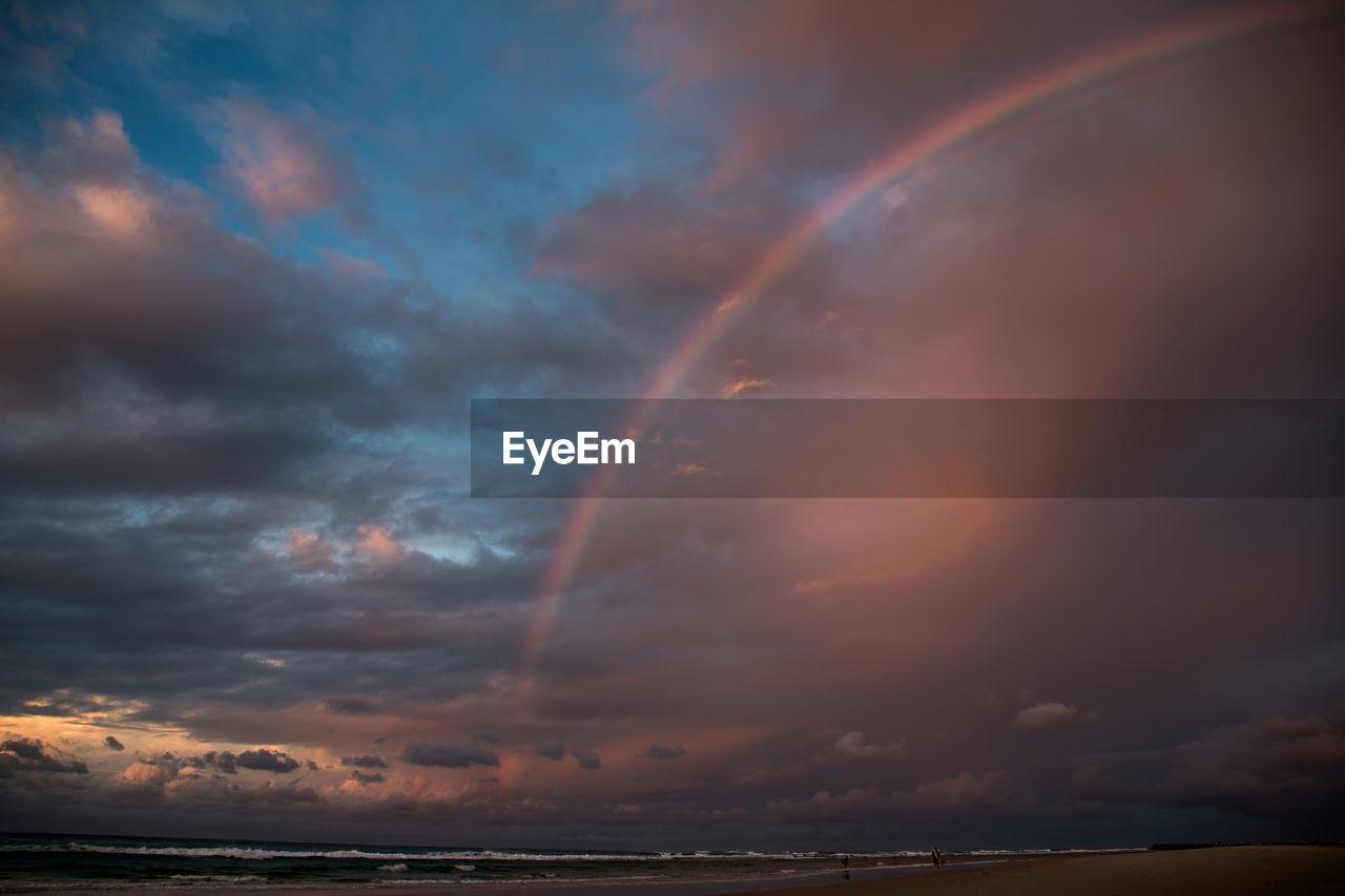 cloud - sky, sky, beauty in nature, water, scenics - nature, sea, horizon, rainbow, tranquility, sunset, nature, idyllic, tranquil scene, horizon over water, no people, dramatic sky, overcast, outdoors, double rainbow