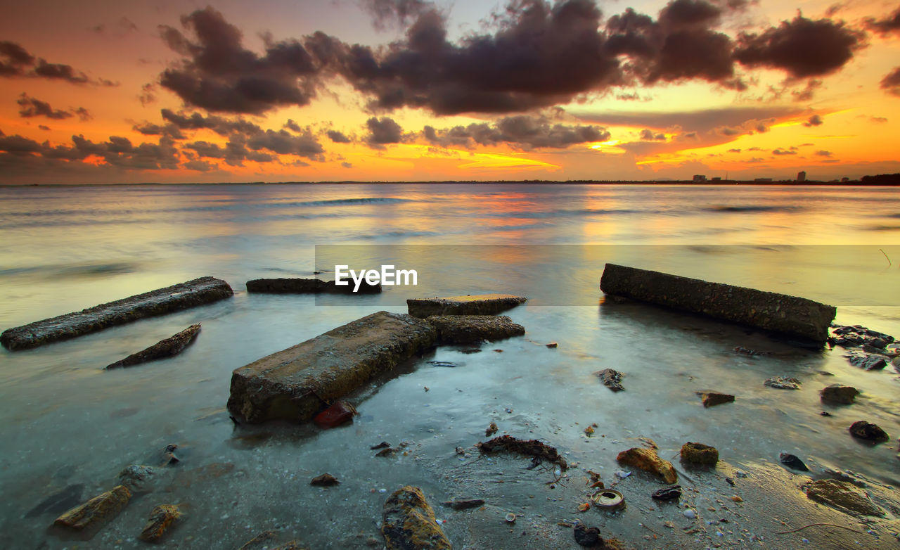 sunset, sky, cloud - sky, scenics - nature, water, beauty in nature, tranquility, tranquil scene, orange color, beach, sea, nature, land, horizon over water, no people, idyllic, horizon, rock, non-urban scene